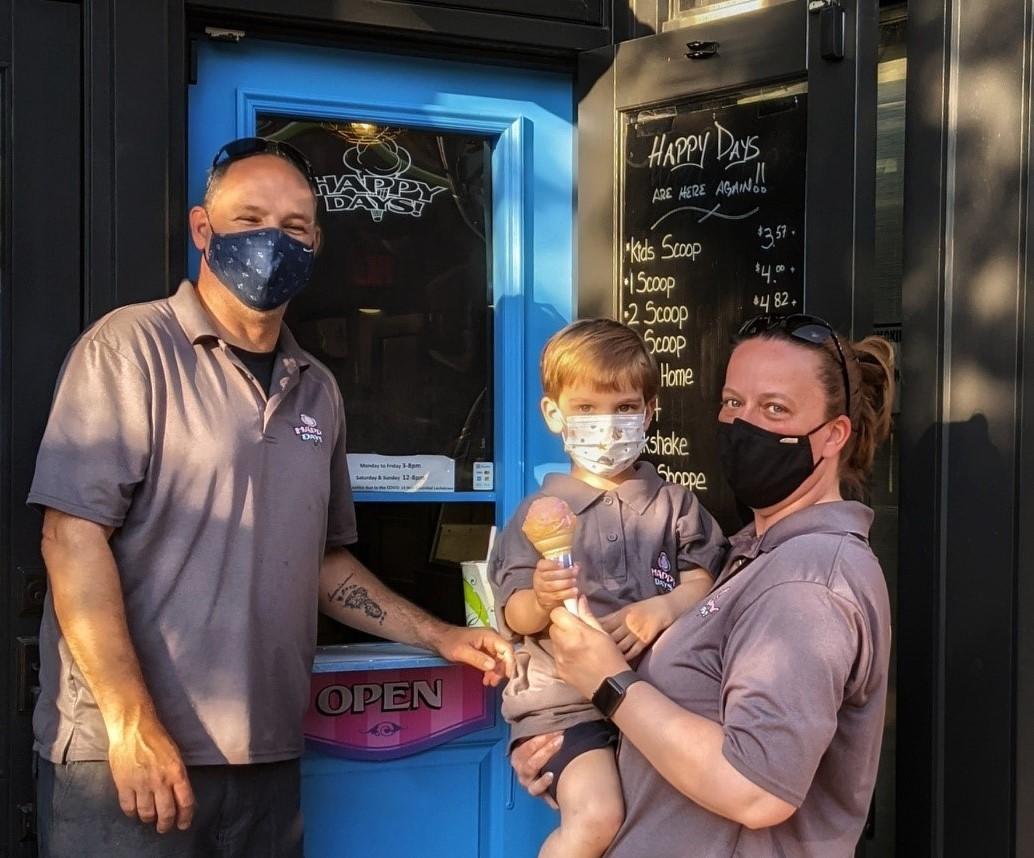 James Tammy and their son in front of Happy Days Ice Cream parlour