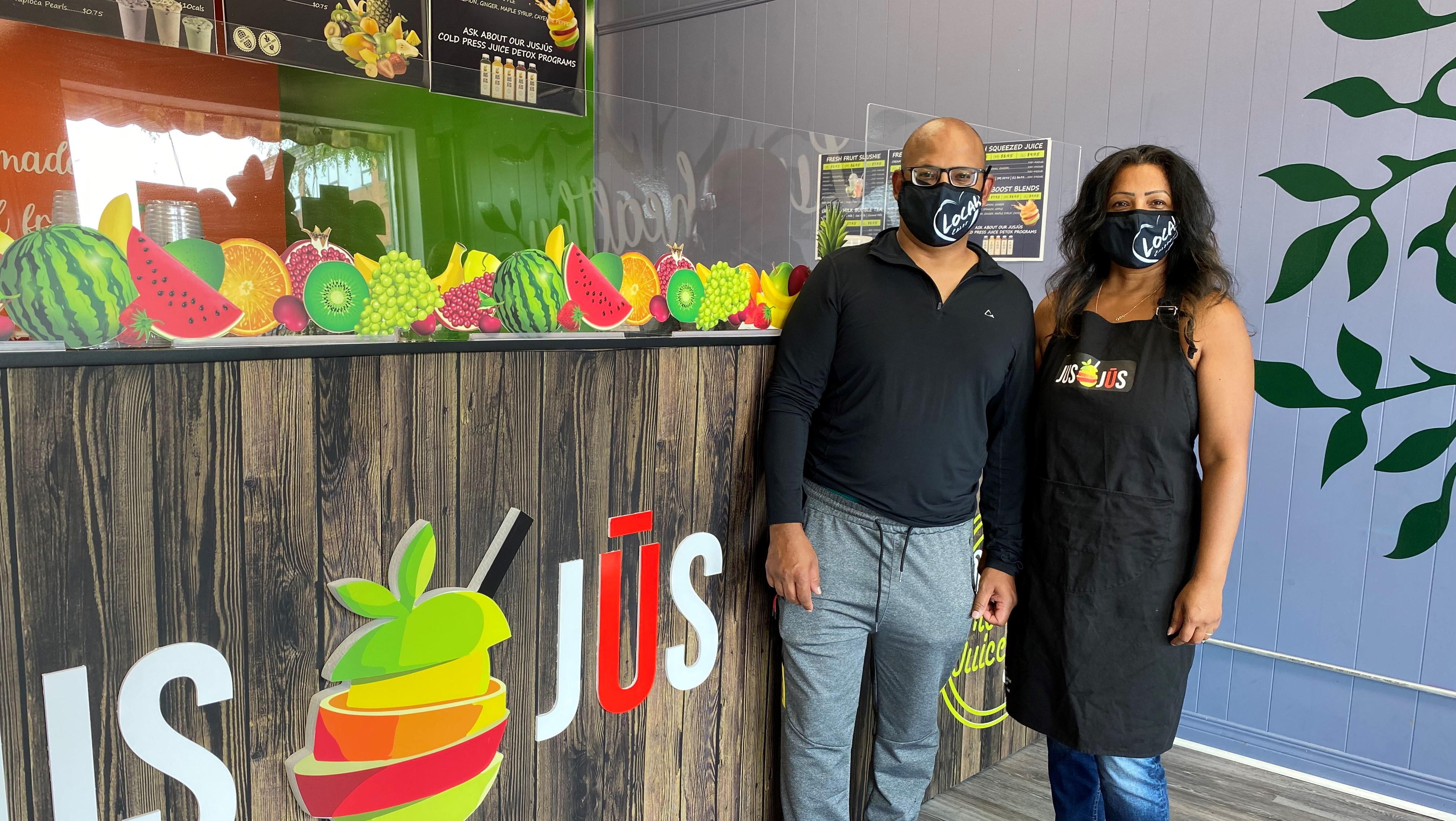 Kam and Suruj in their Jus Jus store