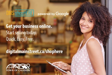 Small business owner smiling in storefront